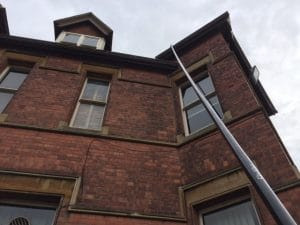 Gutter Clearing High Reach